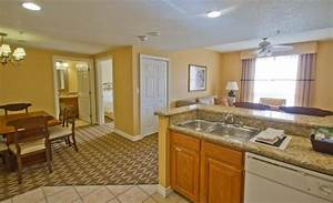 Open floor plan to dining and living room from kitchen for Wyndham grand desert room floor plans