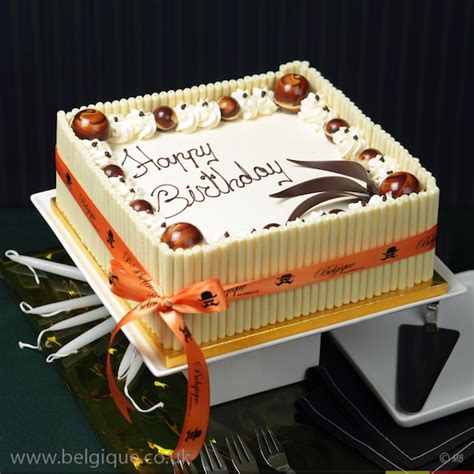 buttercream gateau celebration cake by belgique with white chocolate decoration available for