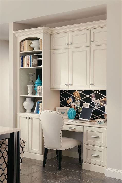 A Builtin Desk With Bookcase And Cabinets Creates A
