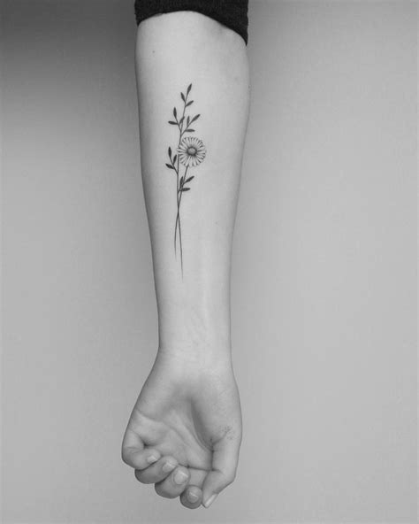 Pin by amyoopsisme e on Tattoos | Tattoos, Daisy flower tattoos, Wrist tattoos