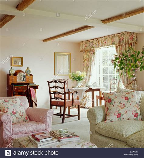 carpet bedroom ideas pink floral cushions on pink armchair and pale green sofa