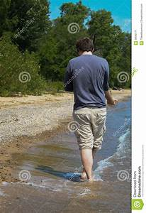 Young Man On The Beach Shore Stock Photo - Image: 58592111