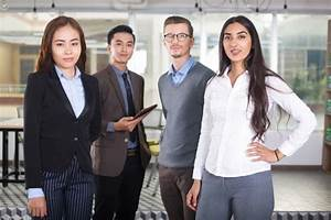 Confident Young Business Team of Four People Photo   Free ...