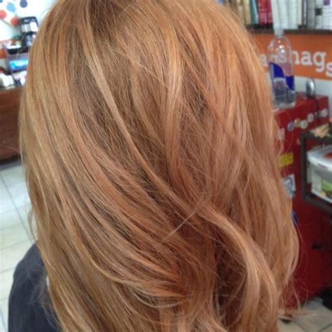 strawberry blonde highlights add  warm blonde
