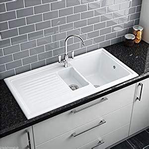 white ceramic 1 5 bowl kitchen sink reginox rl301cw 1 5 bowl white ceramic reversible inset 2041