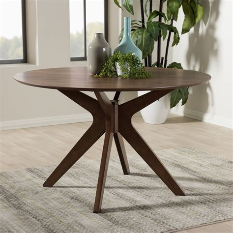 This is a classic mid century danish modern smooth line design table. Baxton Studio Monte Mid-Century Modern Walnut Wood 47-Inch Round Dining Table