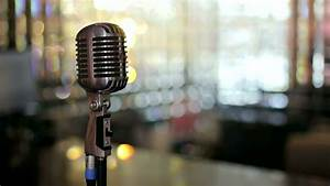 Close-up Of Retro Microphone With Blurred Lights At ...