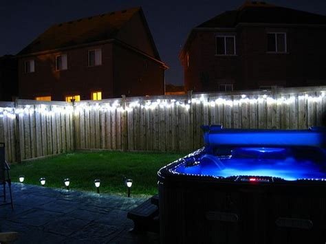 low voltage pool cage lighting string lights along your fence for backyard lighting is