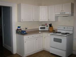 White kitchen cabinets with white appliances, tips and ...