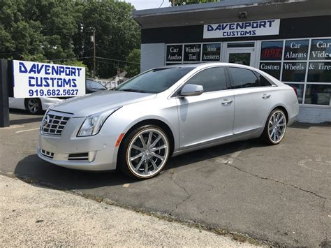 cadillac xts with 20 quot chrome rims on vogue tires yelp