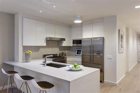 Modern Condo Kitchen With Crisp White Cabinets  Hgtv