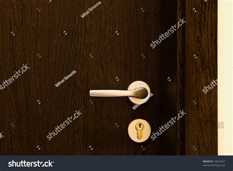 golden door handle on brown wooden door stock photo 14815447 shutterstock