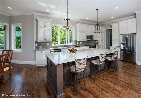 what of flooring is best for kitchens open concept kitchen from the butler ridge home plan 1320 2235