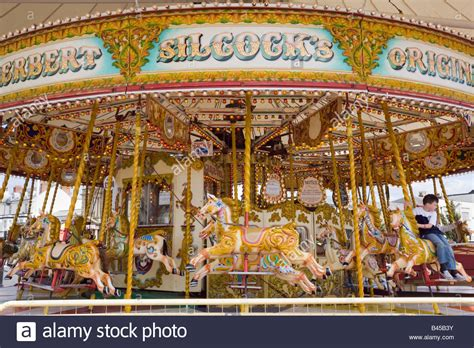 england uk traditional merry go round carousel ride with