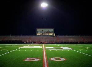Illuminated American Football Field At Night Photograph by ...