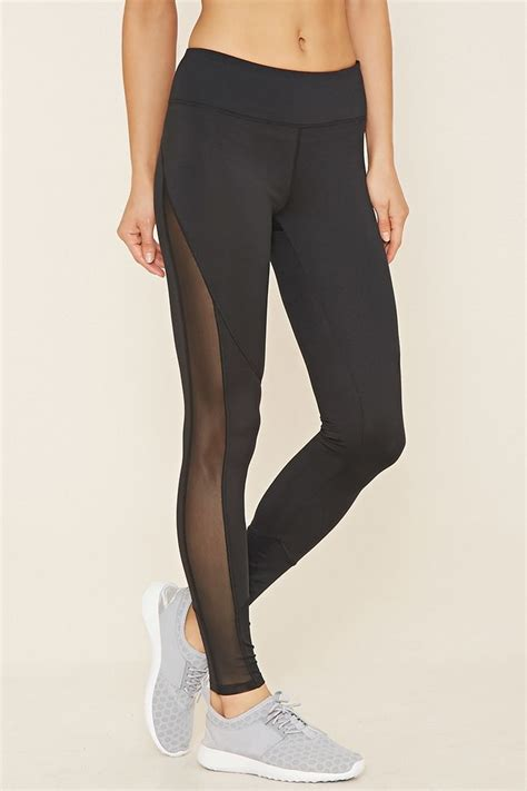 A pair of stretch knit athletic leggings with moisture management a hidden key pocket and a ...