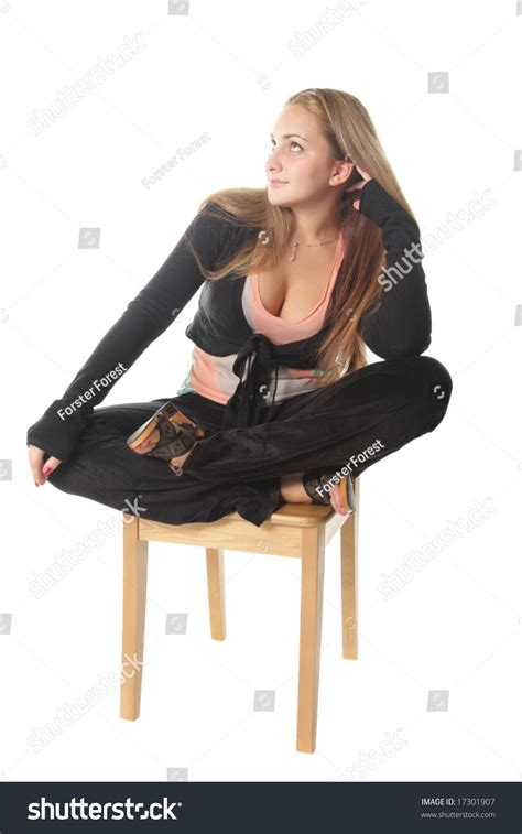 sitting on chair with crossed legs isolated