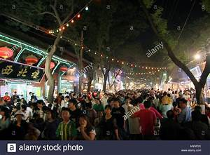 Busy crowded street night market in the Muslim Quarter Xi ...