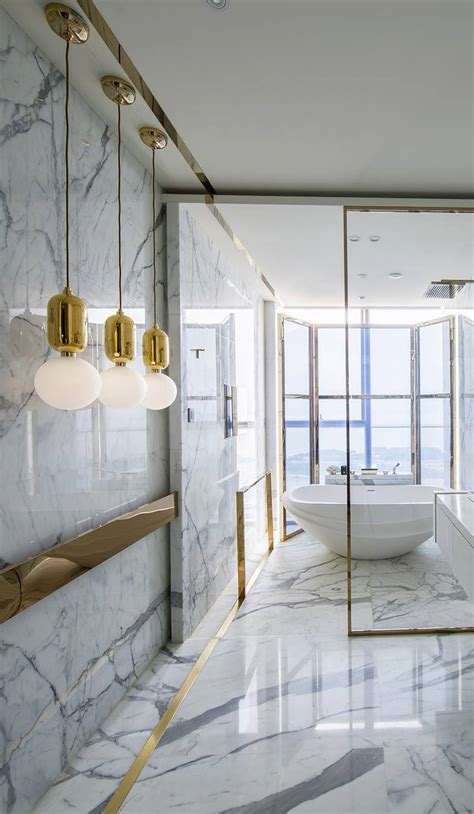 gorgeous marble bathrooms  brass gold fixtures