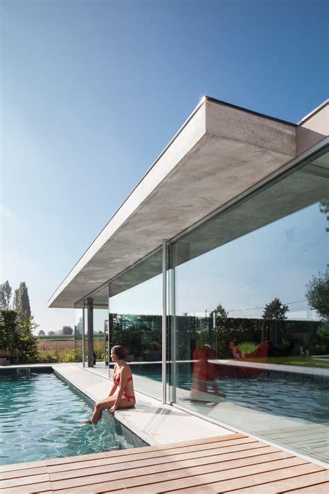 lieven dejaeghere designs  glass  concrete pool house  belgium