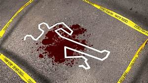 Do Not Cross tape around a crime scene with a blood spot ...