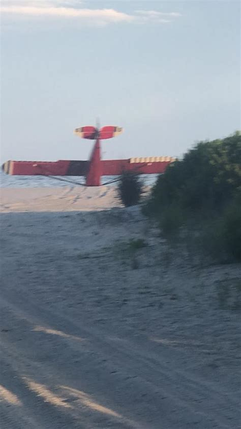pilot flees  plane lands  restricted coast guard
