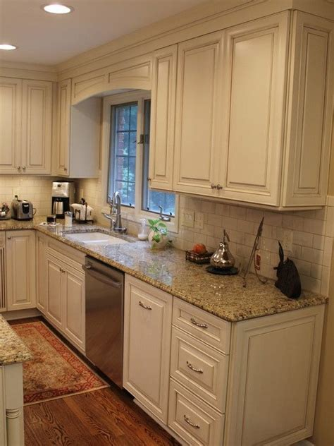 cream cabinets with glaze cream subway tile and distressed kitchen cabinets cream