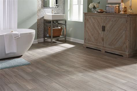 Groutable Vinyl Tile In Bathroom by Stainmaster 174 6 In X 24 In Groutable Chateau Light Gray