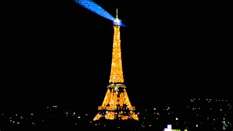 eiffel tower at night wallpaper light show wallpaper wiki