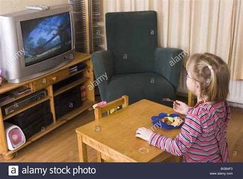 Little Girl Watching Dvds On Television Tube In Living Sheffield Kitchen Appliances With Recessed Lighting Stainless Bundle Appliance Deal Target Island Cart Undercabinet Unique Light Fixtures Dining Table