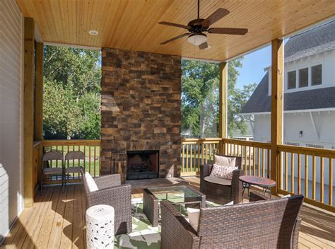 Screened Porch With Natural Stone Fireplace