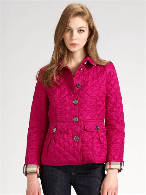 burberry quilted jacket burberry brit quilted jacket in pink lyst