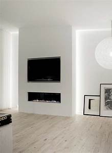 Tv wall with hidden fireplace
