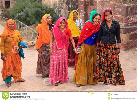 indian women  colorful saris walking   stairs