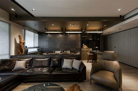 guys home interiors stone and wood make a dark masculine interior
