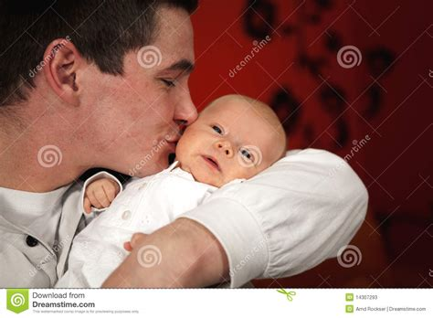 Proud Young Father Kissing His Daughter Stock Photography