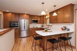 White Quartz Countertops With Cherry Cabinets