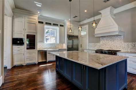 Beautiful Kitchen With Blue Island And White Granite
