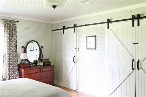 barn door wall keeping it cozy a wall of sliding barn doors