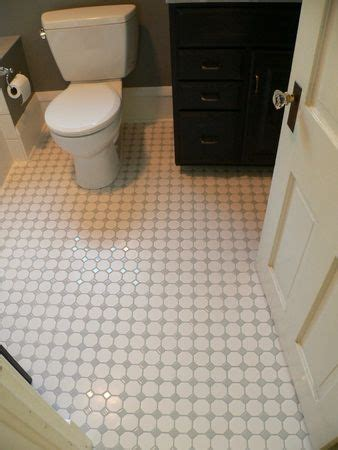 Two inch white hex tiles with gray diamond insets shine on