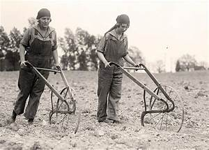 Vintage photo of young women breaking the soil with hand ...