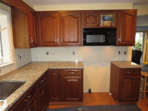 how to install backsplash in kitchen how to install a glass tile kitchen backsplash part 2