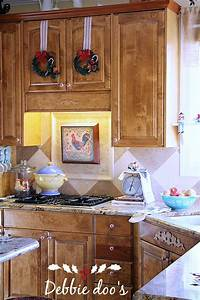 easy christmas decorating ideas for the kitchen debbiedoo39s With kitchen cabinets lowes with dollar tree wall art