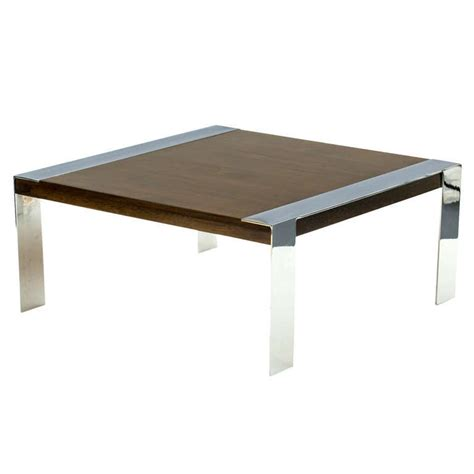 Vintage coffee table with chrome frame and wood top.the table is long and narrow and looks great in modern. Milo Baughman Chrome and Walnut Coffee Table For Sale at 1stdibs