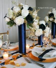 tall reception centerpieces made with navy ivory and gold