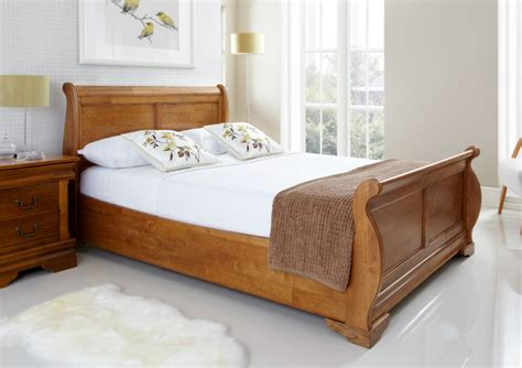 hammered l base louie wooden sleigh bed oak finish light wood wooden