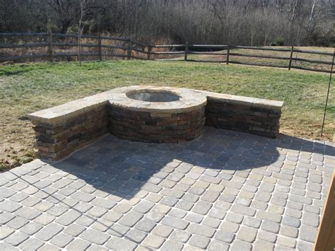 paver patio with firepit in by archadeck