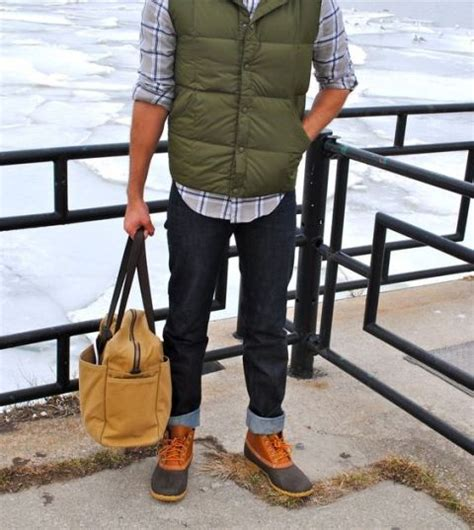 Picture Of With plaid shirt puffer vest cuffed jeans and big bag
