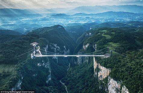 Tourists swarm onto the world's longest glass bridge in ...