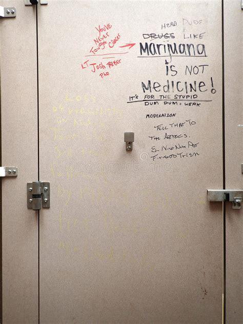 graffiti  bathroom stall door editorial photography
